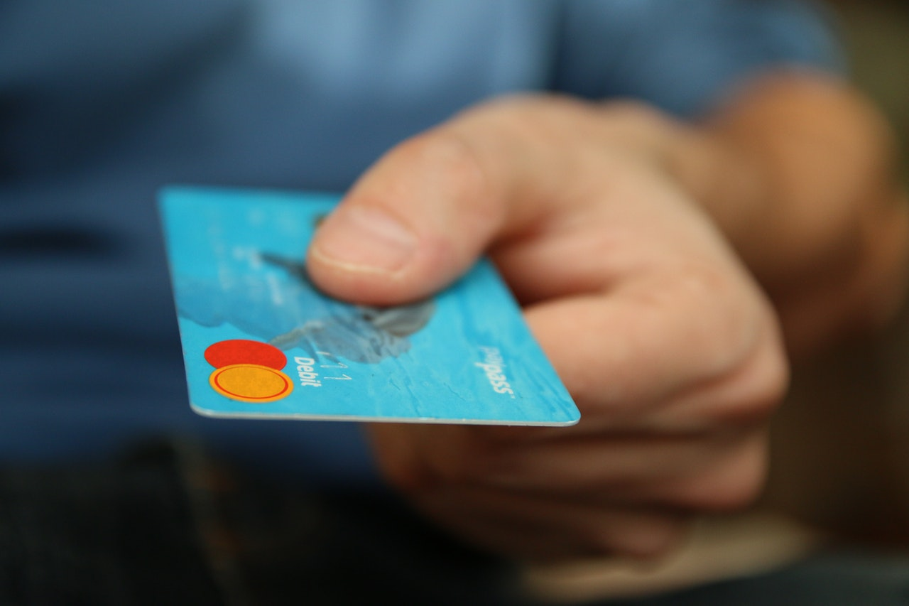 man holding a debit or credit card