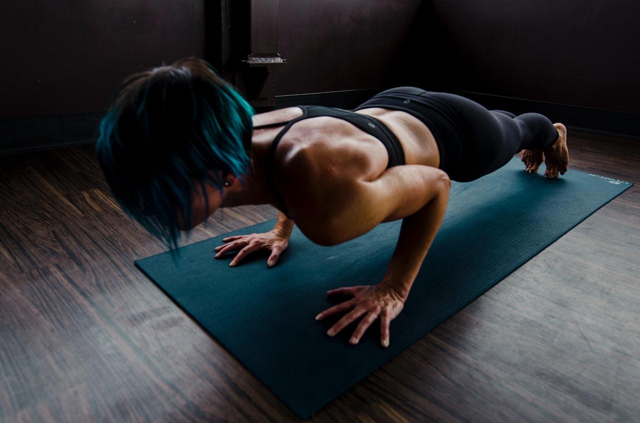 woman doing push ups workout