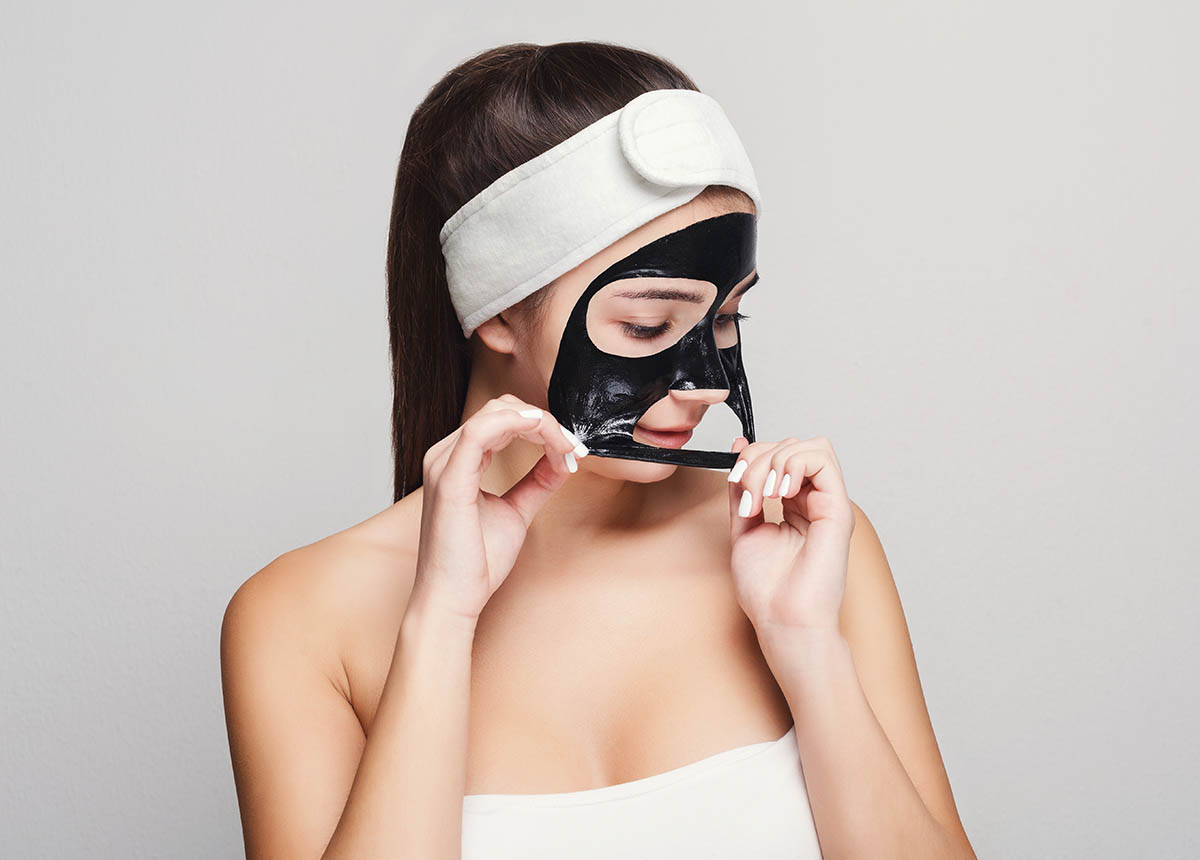 Young girl with chemical peel face mask