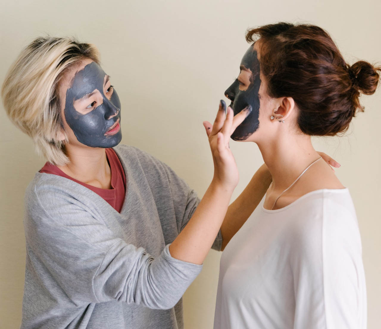 young women applying chemical peels on face