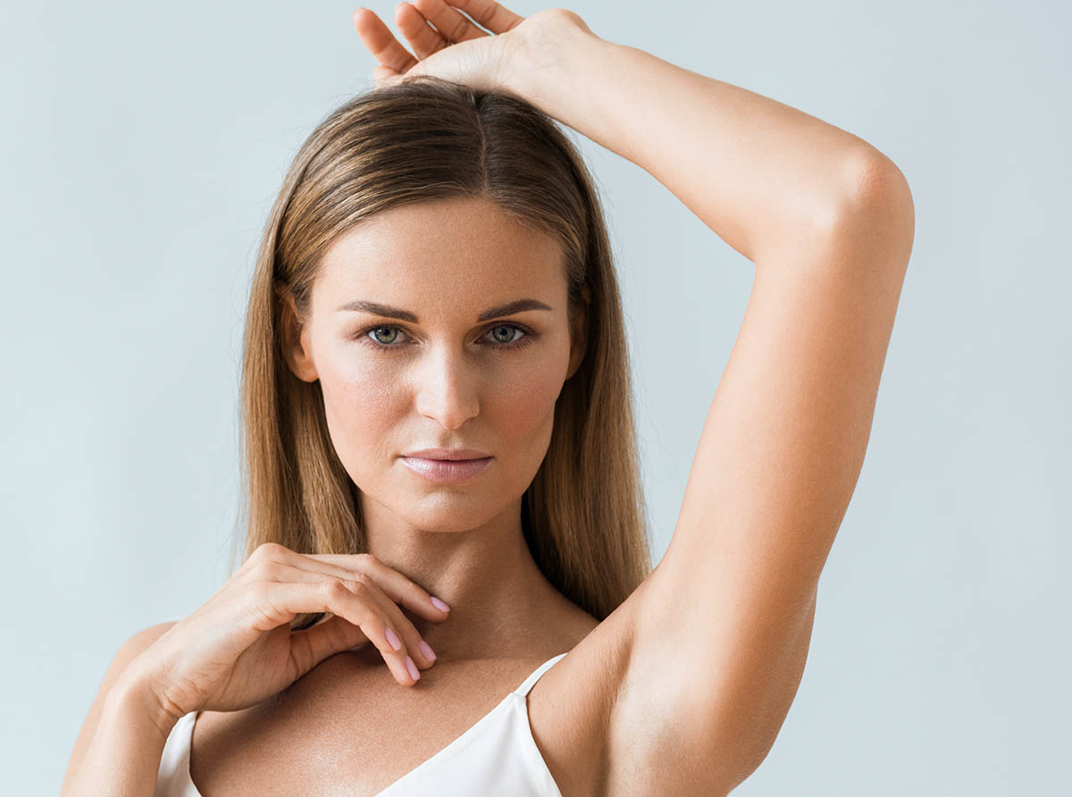 Armpit woman hand up underarm whitening